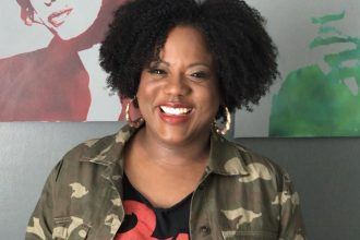 Headshot of Toya wearing a colorful graphic t-shirt