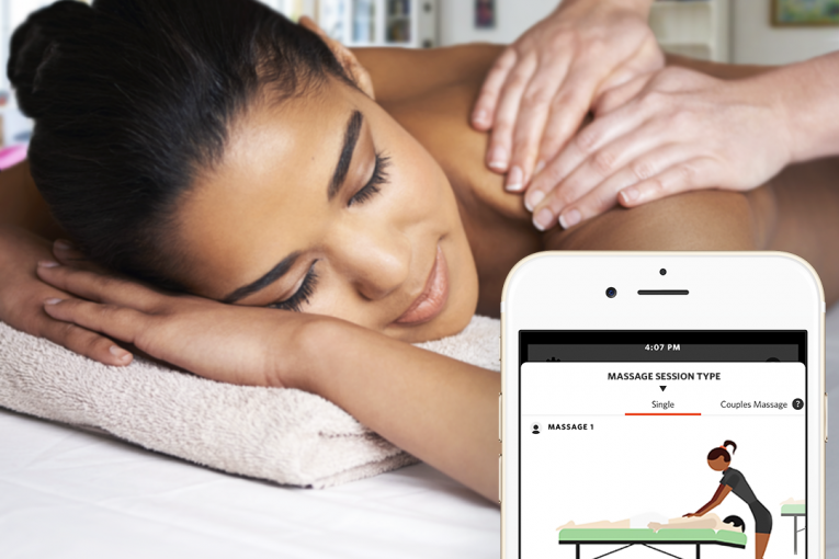Woman lays face down on a massage table during a massage session. The interface of the Zeel Massage app is also shown.