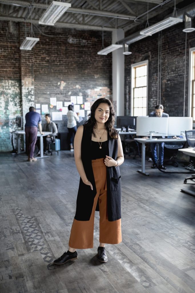 Confident creative woman in loft office