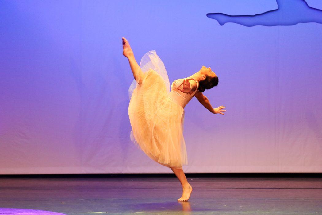 Amanda dances onstage